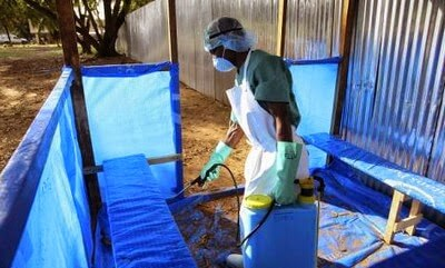 Spraying of disinfectant in hospital waiting area picture
